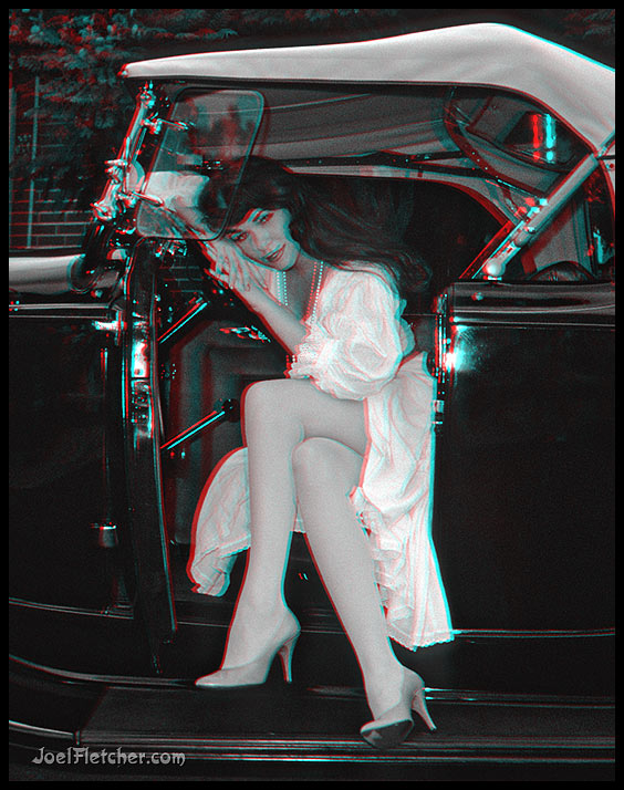 Lovely girl in an antique automobile. gallery