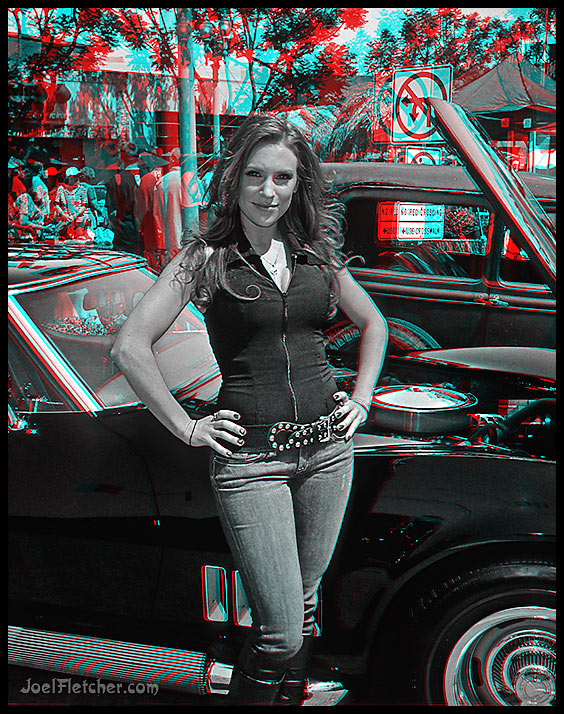 Pretty woman poses in front of car. gallery
