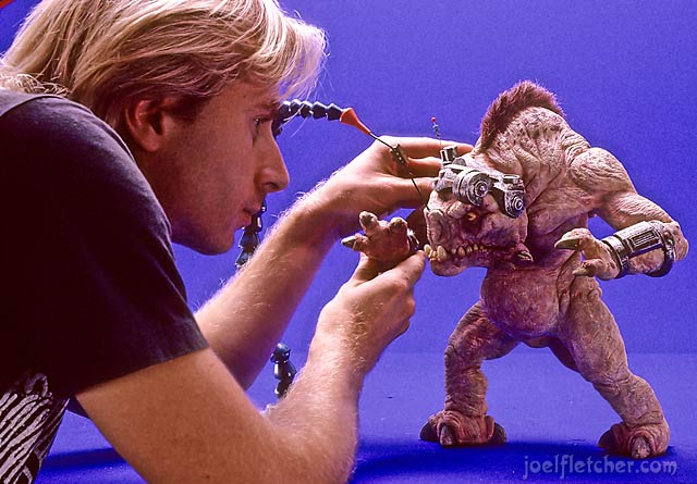Animator with monster puppet.
