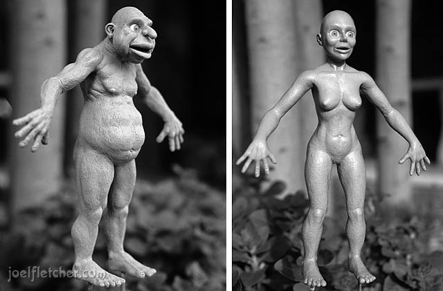 Sculptures of a cave man and cave woman. edge