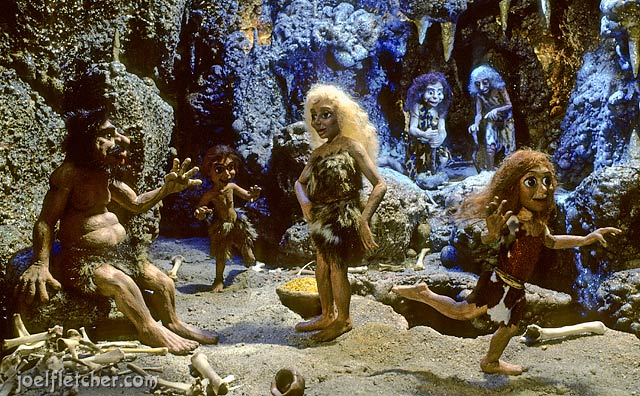 A group of cavemen at home in their cave. edge