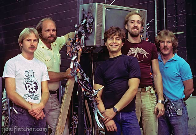Special effects artists pose by the Freddy TV. edge