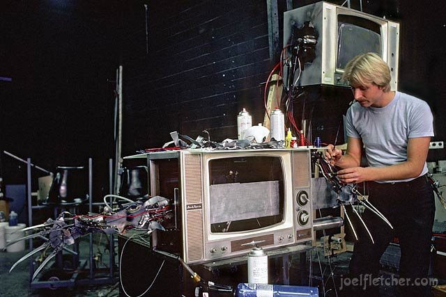Artist working on the TV from Nightmare on Elm Street 3