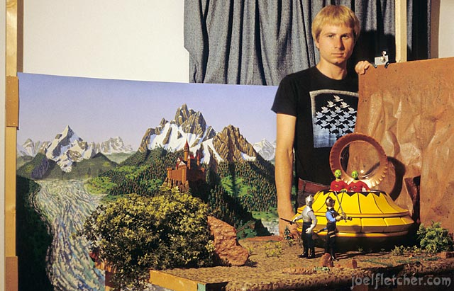Animator Joel Fletcher with stop-motion set for the film ENCOUNTER, 1982