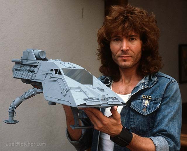 Man holds a spacecraft model. edge