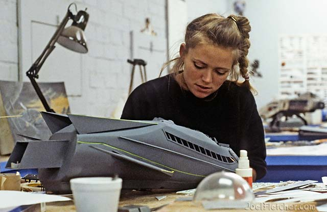 Woman building a space ship model. edge
