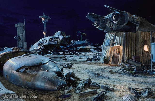 Wrecked spaceship in futuristic junkyard. edge