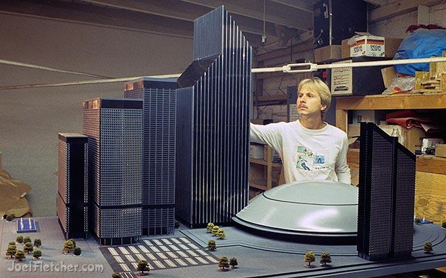Artist Joel Fletcher with architectural model. edge