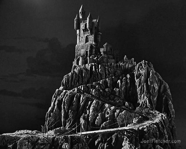 Scary castle on hilltop. edge