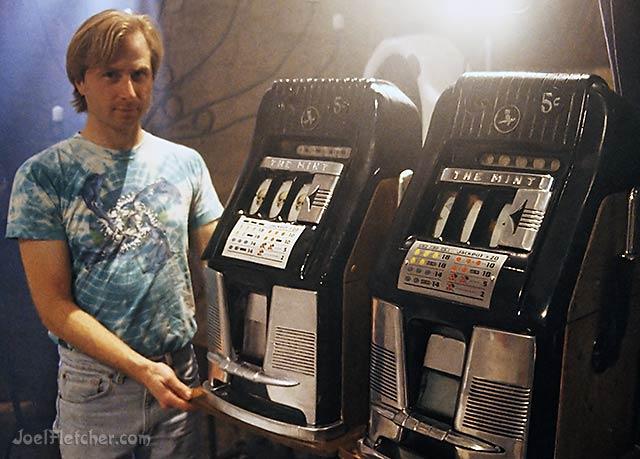Joel Fletcher with replica slot machine and original. edge