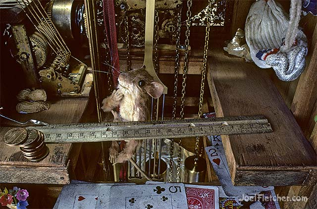 Ralph Mouse in his grandfather clock home. edge