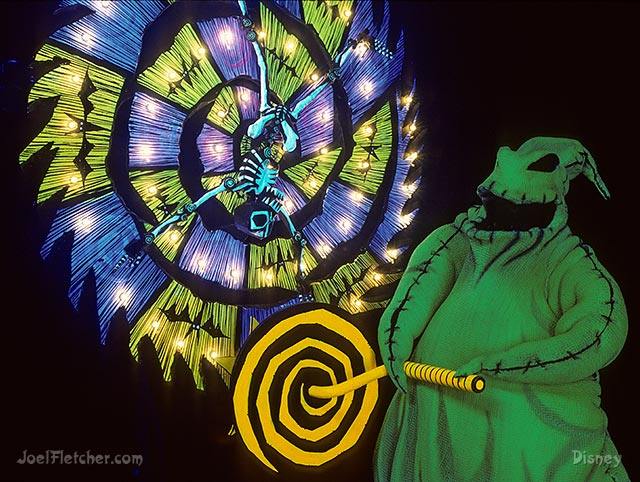 Scary Oogie Boogie cranks a wheel. edge
