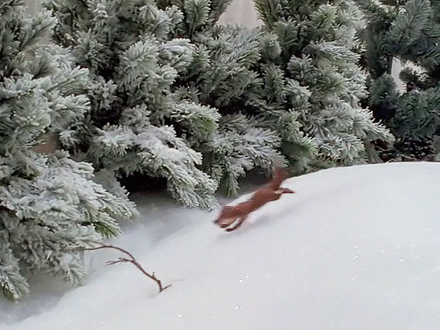 An animated clay fox runs in the snow