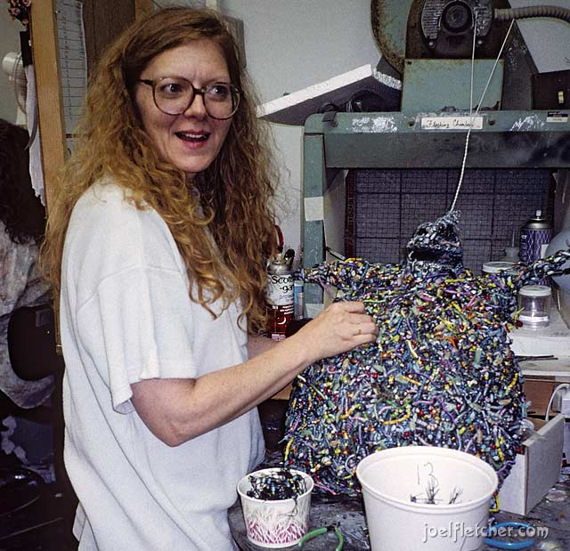 Bonita DeCarlo placing bugs on the Oogie Boogie puppet. edge
