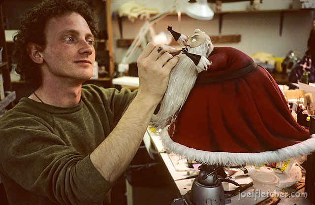 Puppet maker Michael Wick with Santa. edge