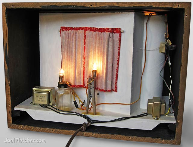 Back view of a shadowbox showing transformers and lights. edge