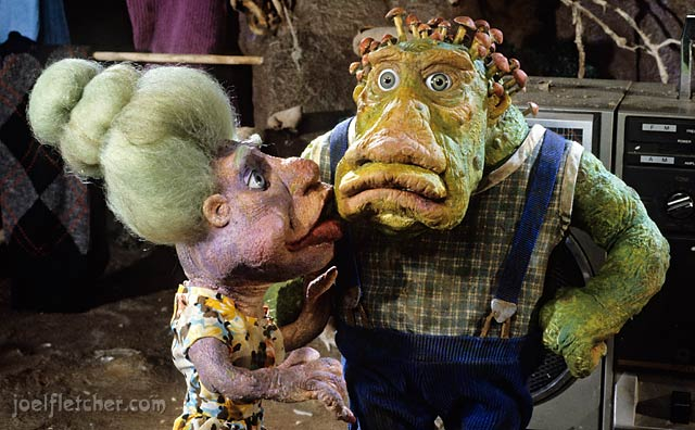 Troll wife kisses her husband. edge