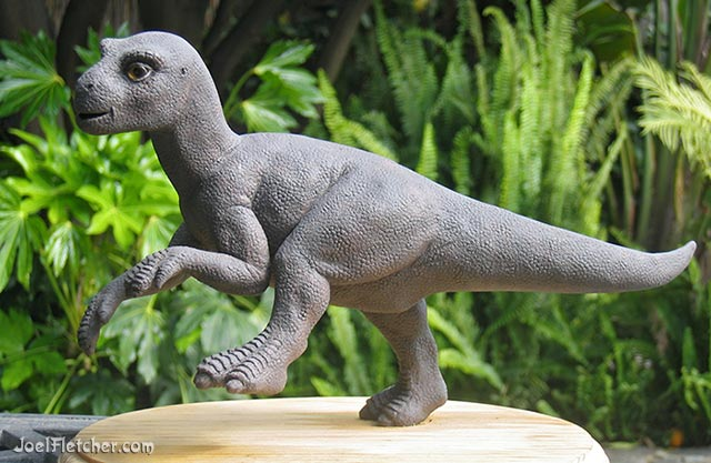 Sculpture of a juvenile Iguanodon dinosaur. edge