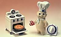 Pillsbury doughboy baking a pie.