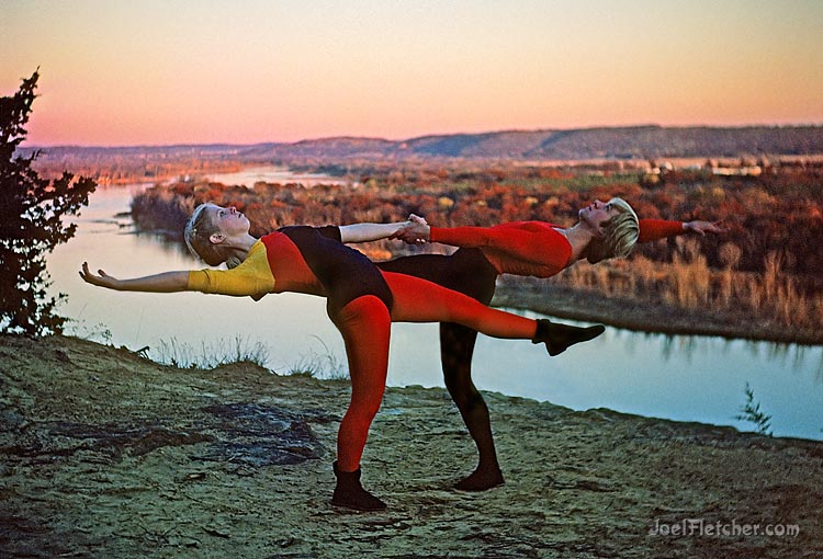 Dancers perform on a bluff over a river. gallery