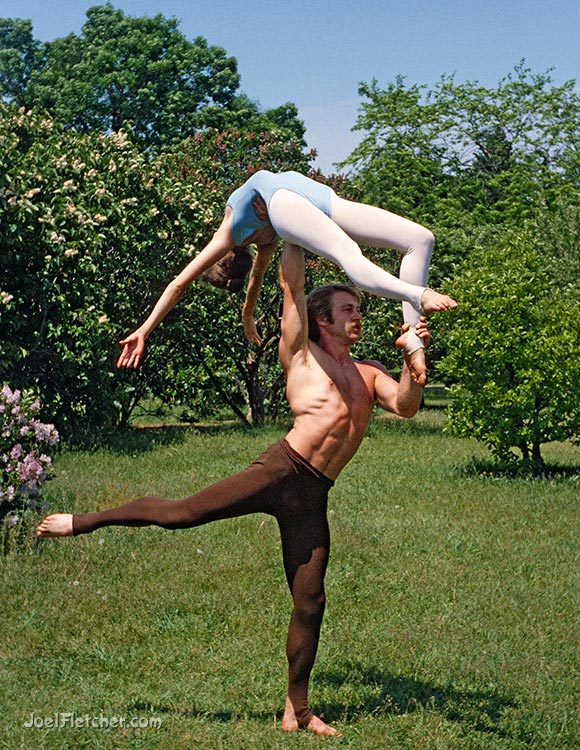 Dancers in a powerful lift pose. gallery