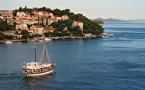 A boat sets off to sea in Dubrovnk, Croatia