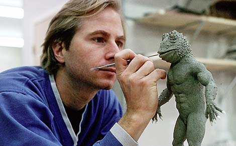Artist Joel Fletcher sculpting an alien creature