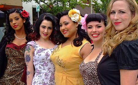 5 beautiful women dressed in retro fashion.