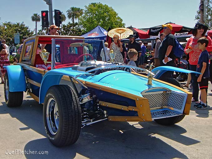 Cool surfer hot rod at a car show.