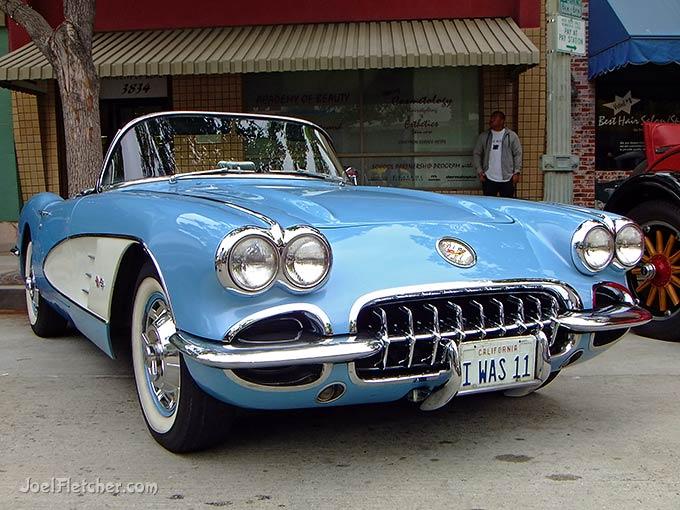 Blue early model Chevrolet Corvette.