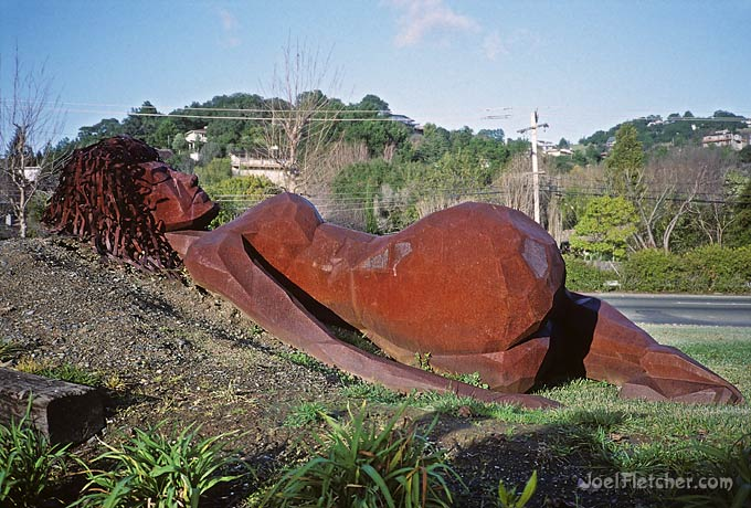 Abstract giant sculpture of a sleeping woman.