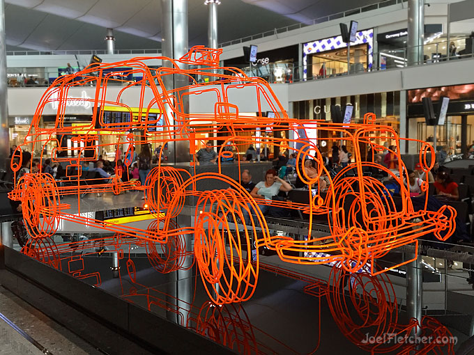 Taxicab sculpture in an airport.