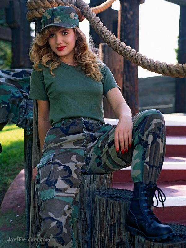 Pretty woman in camouflage outfit