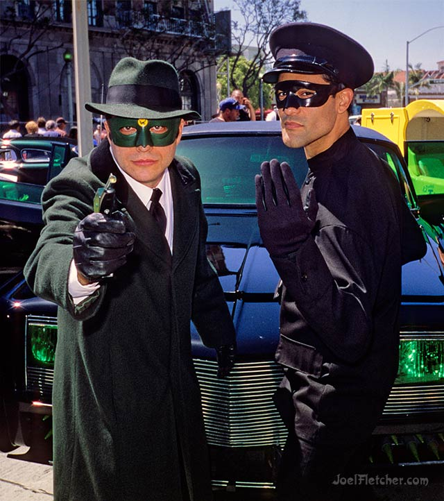 TV heroes the Green Hornet and Kato pose in front of the Black Beauty car