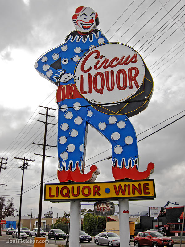 Giant neon clown sign along a road