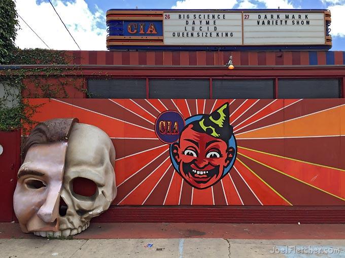 Weird nightclub facade with giant half-face half-skull sculpture