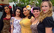 Four women wearing retro style clothes