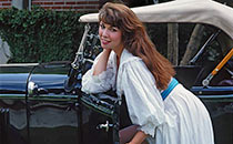 Pretty woman with vintage car