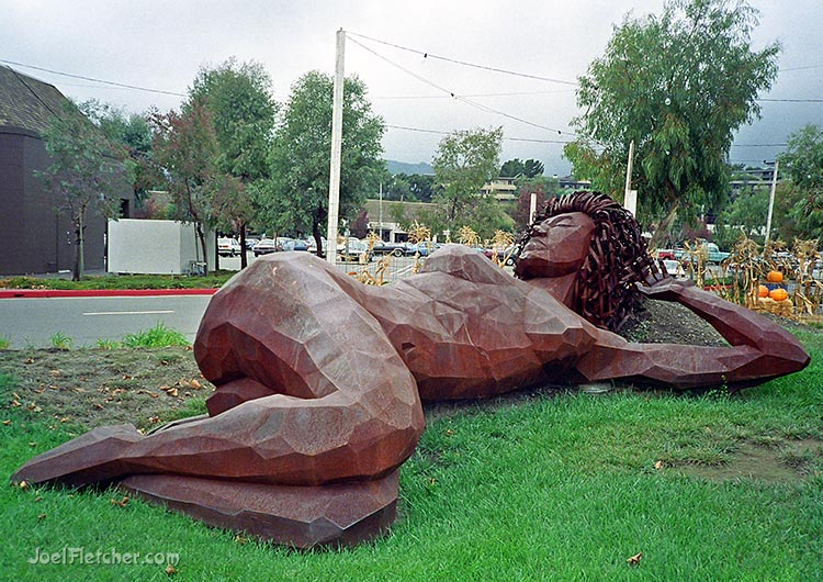 Huge reclining woman statue. gallery
