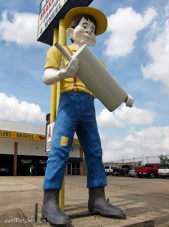 Enormous Muffler Man with goofy head. gallery